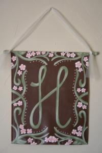 """H"" banner"